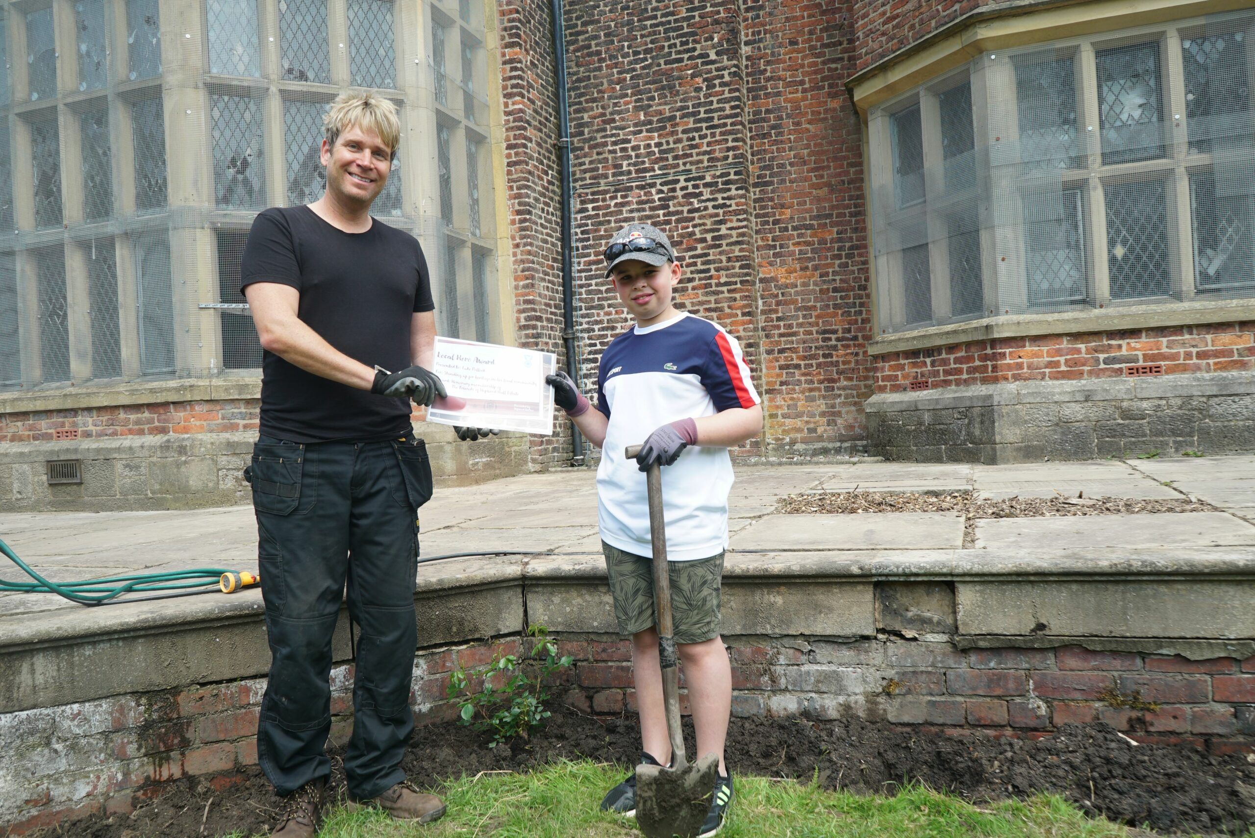 ROCHDALE ONLINE: 'Local hero' Luke Pollock visits Hopwood Hall Estate to receive certificate and plant a special rose: Hopwood Hall Rochdale